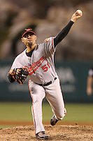 Baltimore Orioles pitcher Mike Gonzalez #51 pitches against the Los Angeles Angels at Angel Stadium on August 20, 2011 in Anaheim,California. Los Angeles defeated Baltimore 9-8.(Larry Goren/Four Seam Images)