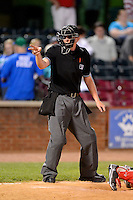 Umpire Lewis Williams makes a call during a game between the Lexington Legends and Greenville Drive on April 18, 2013 at Whitaker Bank Ballpark in Lexington, Kentucky.  Lexington defeated Greenville 12-3.  (Mike Janes/Four Seam Images)