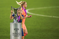 30th August 2020, San Sebastien, Spain;  Eug nie Le Sommer of Lyon with winners medal grabs the trophy after winning the UEFA Womens Champions League football match Final between VfL Wolfsburg and Olympique Lyonnais 3-1
