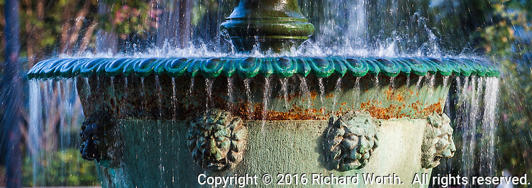 A slow shutter speed smoothes the flowing water in the ornate water fountain at the Meek Estate Park.