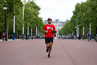 16th May 2020, London, England;  Runner wearing Crisis charity t shirt while running towards Buckingham Palace on the mall