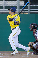 Michigan Wolverines second baseman Hector Gutierrez (24) swings the bat during the NCAA season opening baseball game against the Texas State Bobcats on February 14, 2014 at Bobcat Ballpark in San Marcos, Texas. Texas State defeated Michigan 8-7 in 10 innings. (Andrew Woolley/Four Seam Images)