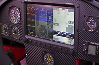 Instrument panel of a Lockwood AirCam aircraft; including the Dynon Avionics Sky Touch electronic flight instrument system, and independent directional gyro, airspeed indicator, and tachometers