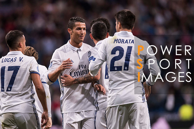 Cristiano Ronaldo of Real Madrid celebrates with teammates during their 2016-17 UEFA Champions League match between Real Madrid vs Sporting Portugal at the Santiago Bernabeu Stadium on 14 September 2016 in Madrid, Spain. Photo by Diego Gonzalez Souto / Power Sport Images