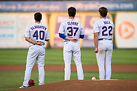 South Bend Cubs Jake Slaughter (40), Chris Clarke (37) and Bryce Ball (22) during the national anthem before a game against the Quad Cities River Bandits on August 20, 2021 at Four Winds Field in South Bend, Indiana.  (Mike Janes/Four Seam Images)
