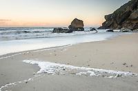 Pastel colours of dawn on beach in Kohaihai near Karamea, Kahurangi National Park, Buller Region, West Coast, New Zealand, NZ