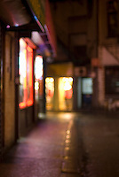 AVAILABLE FOR COMMERCIAL OR EDITORIAL LICENSING FROM GETTY IMAGES.  Please go to www.gettyimages.com and search for image # 163063387.<br /> <br /> Defocused View of a Mysterious Alley in Chinatown on a Rainy Evening, Doyers Street, Chinatown, Lower Manhattan, New York City, New York State, USA
