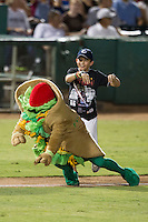 San Antonio Missions mascot Henry the Puffy Taco is pushed down during the Texas League baseball game against the Frisco Roughriders on August 22, 2013 at the Nelson Wolff Stadium in San Antonio, Texas. Frisco defeated San Antonio 2-1. (Andrew Woolley/Four Seam Images)