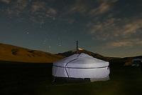 Mongolia, Bayan-Ulgii, Ulgii, Altai Mountai near Tsambagarav Mountain. Night shot of yurt and stars.