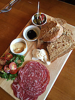 Corbridge, England, UK.  Antipasti in the Black Bull Pub: salami, cherry tomatoes, olives, bread, hummus, buffalo mozzarella.