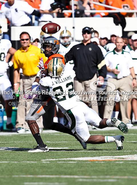 Baylor Bears cornerback Joe Williams (22) and Oklahoma State Cowboys wide receiver Isaiah Anderson (82) in action during the game between the Baylor Bears and the Oklahoma State Cowboys at the Boone Pickens Stadium in Stillwater, OK. Oklahoma State defeats Baylor 59 to 24.