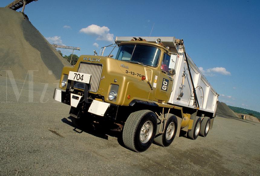 Close-up Mack 5 axle dumptruck, gravel pit. horz. Southbury CT USA.