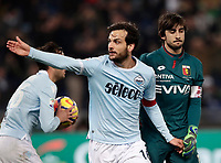 Calcio, Serie A: Lazio - Genoa, Roma, Stadio Olimpico, 5 Febbraio 2018. <br /> Lazio's captain Marco Parolo (c) celebrates after scoring with his teammate Alessandro Murgia (l) next yo Genoa's captain and goalkeeper Mattia Perin (r) during the Italian Serie A football match between Lazio and Genoa at Rome's Stadio Olimpico, February 5, 2018.<br /> UPDATE IMAGES PRESS/Isabella Bonotto