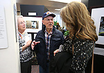 Amy Roby, project manager of the Always Lost: A Meditation on War exhibit talks with Harold and Sherry Siegfried at the Legislative Building in Carson City, Nev., on Monday, April 6, 2015. <br />