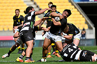 Xavier Numia of Wellington is tackled during the Bunnings NPC - Wellington v Hawke's Bay at Sky Stadium, Wellington, New Zealand on Sunday 26 September 2021.<br /> Photo by Masanori Udagawa. <br /> www.photowellington.photoshelter.com