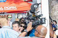 Media surround South Bend mayor and Democratic presidential candidate Pete Buttigieg as he leaves the Iowa Pork Producers Association Pork Tent at the Iowa State Fair in Des Moines, Iowa, on Tues., Aug. 13, 2019.