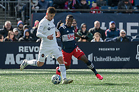 FOXBOROUGH, MA - MARCH 7: Alvaro Medran #10 of Chicago Fire passes the ball under pressure from Cristian Penilla #70 of New England Revolution during a game between Chicago Fire and New England Revolution at Gillette Stadium on March 7, 2020 in Foxborough, Massachusetts.
