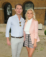 Tom Whitehouse and Amelia Mist at the JR: Chronicles solo exhibition private view, Saatchi Gallery, King's Road, London on Thursday 03 June 2021 in London, England, UK. <br /> CAP/CAN<br /> ©CAN/Capital Pictures