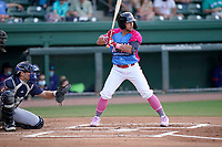 """Second baseman Cam Cannon (4) of the Greenville Drive during a game against the Brooklyn Cyclones on Saturday, May 15, 2021, at Fluor Field at the West End in Greenville, South Carolina. Drive players were wearing jerseys for the """"Ranas de Rio de Greenville"""" (Greenville River Frogs), as part of Minor League Baseball's """"Copa de la Diversion."""" The catcher is Hayden Senger (24). (Tom Priddy/Four Seam Images)"""