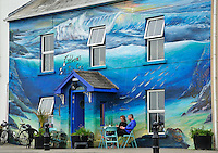 """REPUBLIC of IRELAND - Prov. Donegal<br /> Fishing village MULLAGHMORE<br /> The blue """"Ocean Inn"""" decorated with shells and monkfish on the house front<br /> <br /> Full size: 63 MB"""