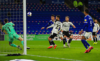 3rd November 2020; Cardiff City Stadium, Cardiff, Glamorgan, Wales; English Football League Championship Football, Cardiff City versus Barnsley; Kieffer Moore of Cardiff City heads at goal but the attempt is saved