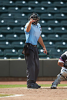 Home plate umpire Dane Poncsak makes a strike call during the Carolina League game between the Potomac Nationals and the Winston-Salem Dash at BB&T Ballpark on August 12, 2018 in Winston-Salem, North Carolina. The Rayados defeated the Nationals 6-3. (Brian Westerholt/Four Seam Images)
