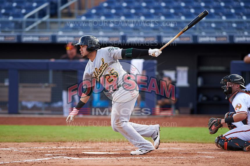Mesa Solar Sox third baseman Renato Nunez (25) at bat during an Arizona Fall League game against the Peoria Javelinas on October 21, 2015 at Peoria Stadium in Peoria, Arizona.  Peoria defeated Mesa 5-3.  (Mike Janes/Four Seam Images)