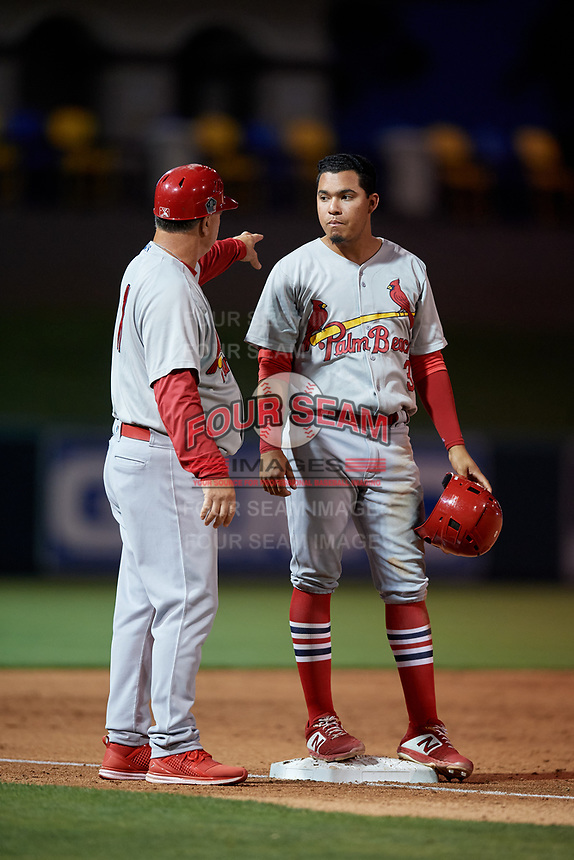 Palm Beach Cardinals manager Dann Bilardello (11) talks with Rayder Ascanio (3) during a Florida State League game against the Lakeland Flying Tigers on April 17, 2019 at Publix Field at Joker Marchant Stadium in Lakeland, Florida.  Lakeland defeated Palm Beach 1-0.  (Mike Janes/Four Seam Images)
