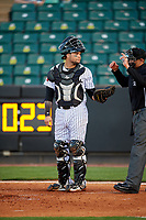 Jackson Generals catcher Oscar Hernandez (28) and home plate umpire Brock Ballou during a game against the Chattanooga Lookouts on April 27, 2017 at The Ballpark at Jackson in Jackson, Tennessee.  Chattanooga defeated Jackson 5-4.  (Mike Janes/Four Seam Images)