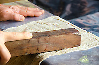 Roen Hufford uses a wooden tool on paper mulberry bark as part of the process of making kapa (or tapa), Big Island.