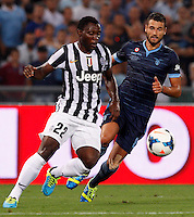 Calcio, Supercoppa di Lega: Juventus vs Lazio. Roma, stadio Olimpico, 18 agosto 2013<br /> Lazio midfielder Antonio Candreva, right, is challenged by Juventus midfielder Kwadwo Asamoah during the Italian League Supercup football final match between Juventus and Lazio, at Rome's Olympic stadium,  18 August 2013.<br /> UPDATE IMAGES PRESS/Riccardo De Luca