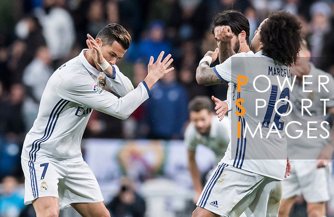 Cristiano Ronaldo of Real Madrid celebrates with teammates during their La Liga match between Real Madrid and Real Betis at the Santiago Bernabeu Stadium on 12 March 2017 in Madrid, Spain. Photo by Diego Gonzalez Souto / Power Sport Images