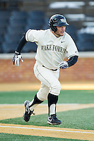 Nate Mondou (10) of the Wake Forest Demon Deacons hustles down the first base line against the Towson Tigers at Wake Forest Baseball Park on February 15, 2014 in Winston-Salem, North Carolina.  The Tigers defeated the Demon Deacons 5-4.  (Brian Westerholt/Four Seam Images)