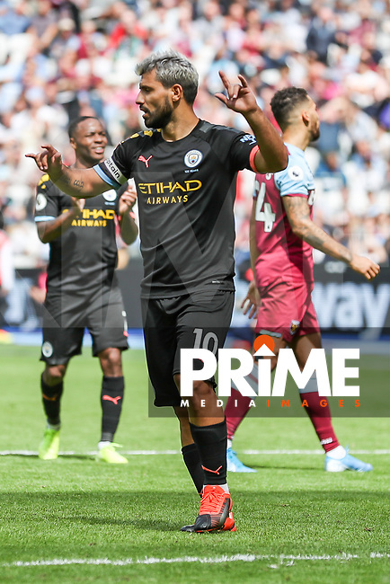 GOAL - Sergio Aguero of Manchester City celebrates after he scores from the penalty spot to make the score 0-4 during the Premier League match between West Ham United and Manchester City at the London Stadium, London, England on 10 August 2019. Photo by David Horn.