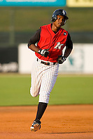 Brandon Short #13 of the Kannapolis Intimidators rounds the bases after hitting a home run at Fieldcrest Cannon Stadium July 24, 2009 in Kannapolis, North Carolina. (Photo by Brian Westerholt / Four Seam Images)