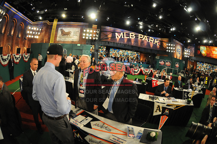 Pitcher Andrew Heaney (Oklahoma State) the number nine overall pick to the Miami Marlins is greeted by Marlin officials Bill Beck and Jack McKeon during the MLB Draft on Monday June 04,2012 at Studio 42 in Secaucus, NJ.   (Tomasso DeRosa/ Four Seam Images)