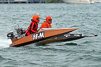 58-M and 146-M  (Outboard Marathon Runabout)<br /> <br /> Trenton Roar On The River<br /> Trenton, Michigan USA<br /> 17-19 July, 2015<br /> <br /> ©2015, Sam Chambers
