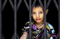 The Images from the Book Journey through Color and Time, 2006, Yangon, a boy is waiting for? What will the future bring?<br /> Myanmar, Burma
