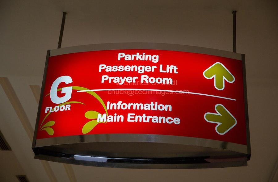 Yogyakarta, Java, Indonesia.  Ambarrukmo Shopping Mall Sign Pointing to Muslim Prayer Room.