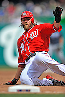 2 April 2011: Washington Nationals outfielder Jayson Werth slides safely into third during play against the Atlanta Braves at Nationals Park in Washington, District of Columbia. The Nationals defeated the Braves 6-3 in the second game of their season opening series. Mandatory Credit: Ed Wolfstein Photo