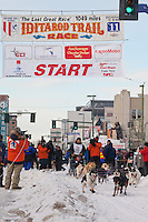 Musher Ramey Smyth and Iditarider Gill Kenny.leave the 2011 Iditarod ceremonial start line in downtown Anchorage, Alaska