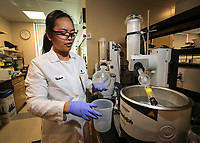 July 19.  2019. San Diego, CA. |  Turning Point Therapeutics's Associate Medicinal Chemistry Vivian Nguyen works on the Rotovap in the companies lab in La Jolla. | Photos by Jamie Scott Lytle. Copyright.