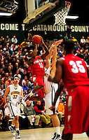 21 January 2010: Stony Brook University Seawolves' guard Eddie Castellanos (12), a Senior from Jersey City, NJ, goes for a layup against the University of Vermont Catamounts at Patrick Gymnasium in Burlington, Vermont. The Catamounts fell to the Seawolves 65-60 in the America East matchup. Mandatory Credit: Ed Wolfstein Photo