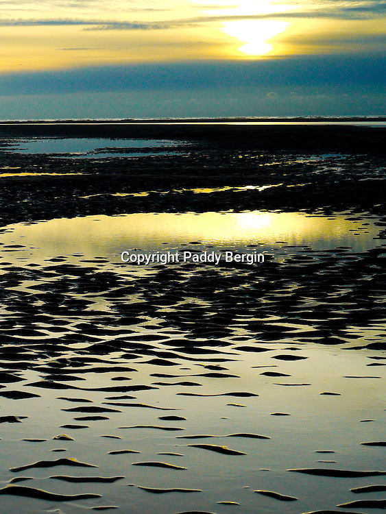 A poster view from the sands of Ynyslas Beach on the west coast in Ceredigion, Wales,<br /> <br /> Ynyslas has a large sandy beach and dunes at low tide. Always wonderful views and wildlife.<br /> <br /> Stock Photo by Paddy Bergin