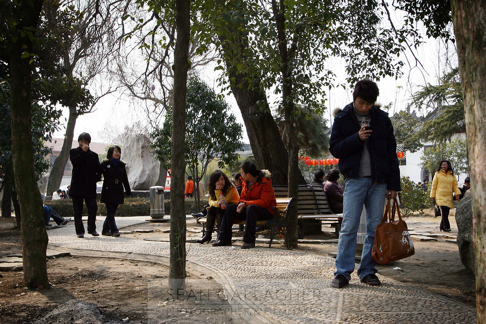 CHINA. Hubei Province. Wuhan. Wuhan (population 4.3 million) is a sprawling city that sits on both sides of the Yangtze River. Young people relaxing in a park. 2008