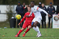 Freddie Card of Aveley and Ridwan Ajala of Romford during Romford vs Aveley, Pitching In Ishmian League North Division Football at Mayesbrook Park on 26th September 2020