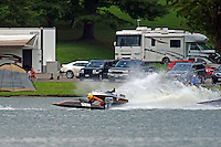 Frame 2: Grant Hearn (12-H) goes for a tumble at the start of the final heat 1.  (runabout)