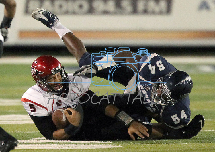 San Diego State's Ryan Katz (5) is tackled by Nevada's Jeremiah Green (54) during the first half of an NCAA college football game in Reno, Nev., on Saturday, Oct. 20, 2012. Katz was injured from Green's tackle and was carted off the field.(AP Photo/Cathleen Allison)