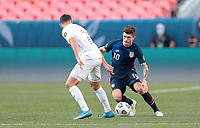 DENVER, CO - JUNE 3: Christian Pulisic #10 of the United States moves with the ball during a game between Honduras and USMNT at EMPOWER FIELD AT MILE HIGH on June 3, 2021 in Denver, Colorado.