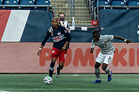 FOXBOROUGH, MA - SEPTEMBER 23: Teal Bunbury #10 of New England Revolution looks to pass as Zachary Brault-Guillard #15 of Montreal Impact closes during a game between Montreal Impact and New England Revolution at Gillette Stadium on September 23, 2020 in Foxborough, Massachusetts.